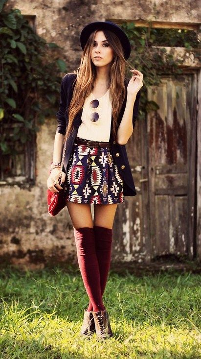 Navy blue coat, white t-shirt, aztec print skirt, burgandy knee-high socks and brown booties. I need everything in this photo. Badly.