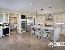 White Kitchen with large island, decorative chimney hood fan, wall ovens, luxury modern farmhouse decor. Our 2014 Cash & Cars for Cancer Lottery Home | The Legacy model by Kimberley Homes  #interiordesign #newhomedesign #homedesign #newhome #customhome #yegre #buildwithkimberley #kimberleyhomes #kitchen #kitchenideas #kitcheninspo #kitchenreno #whitekitchen