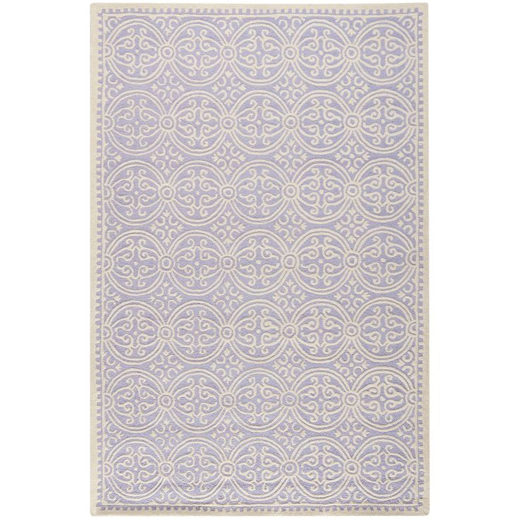 Adorn your living room or bedroom with this handmade wool rug. This hand-tufted rug features an Oriental lavender print and a 100 percent wool pile. Equipped with a durable cotton canvas backing, this piece us sure to withstand everyday wear.