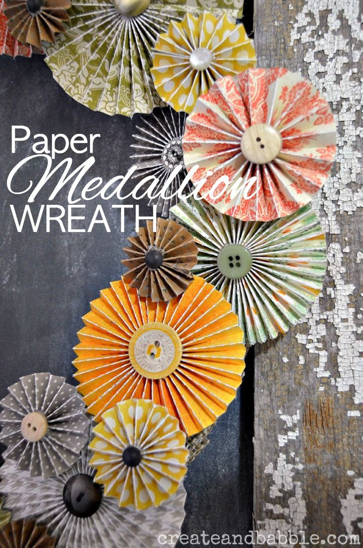 Layering paper medallions on a wreath form makes a pretty Fall Wreath |Paper Medallion Wreath - createandbabble.com