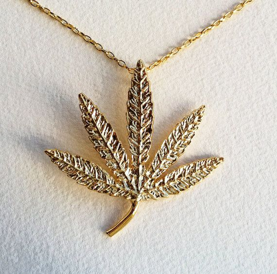 Hey, I found this really awesome Etsy listing at http://www.etsy.com/listing/126363839/gold-large-3-bling-marijuana-necklace
