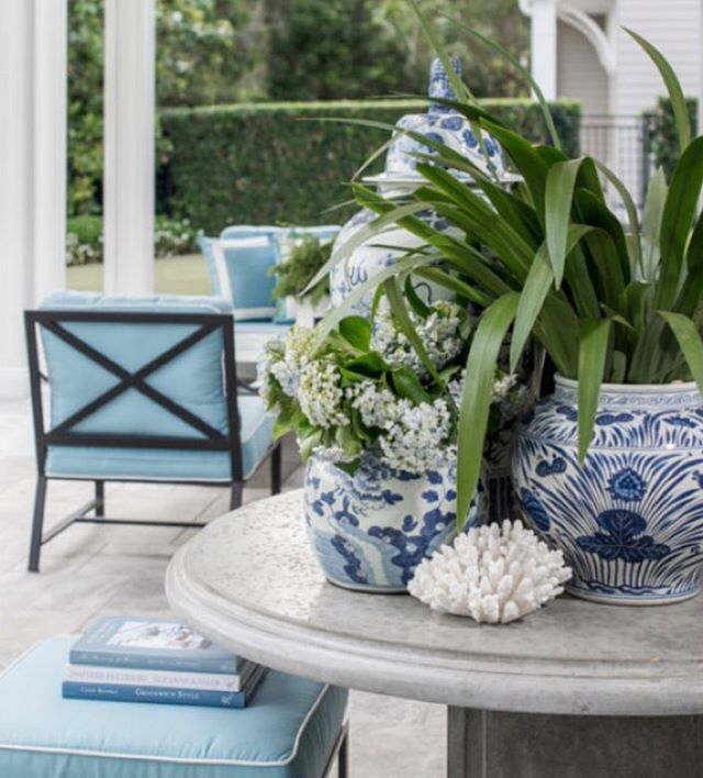 We love clustering blue and white ginger jars filled with green foliage when styling tables outdoors #verandahhouseinteriors #outdoorspaces #brisbaneinteriordesigners #classicdesign #blueforever