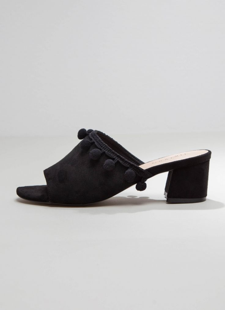 <p>Add a little bit of style to your step with these cute mules!</p> <p>- Mules with a 5cm heels</p> <p>- Pom pom detailing</p> <p>- Faux suede material</p>    <p></p>