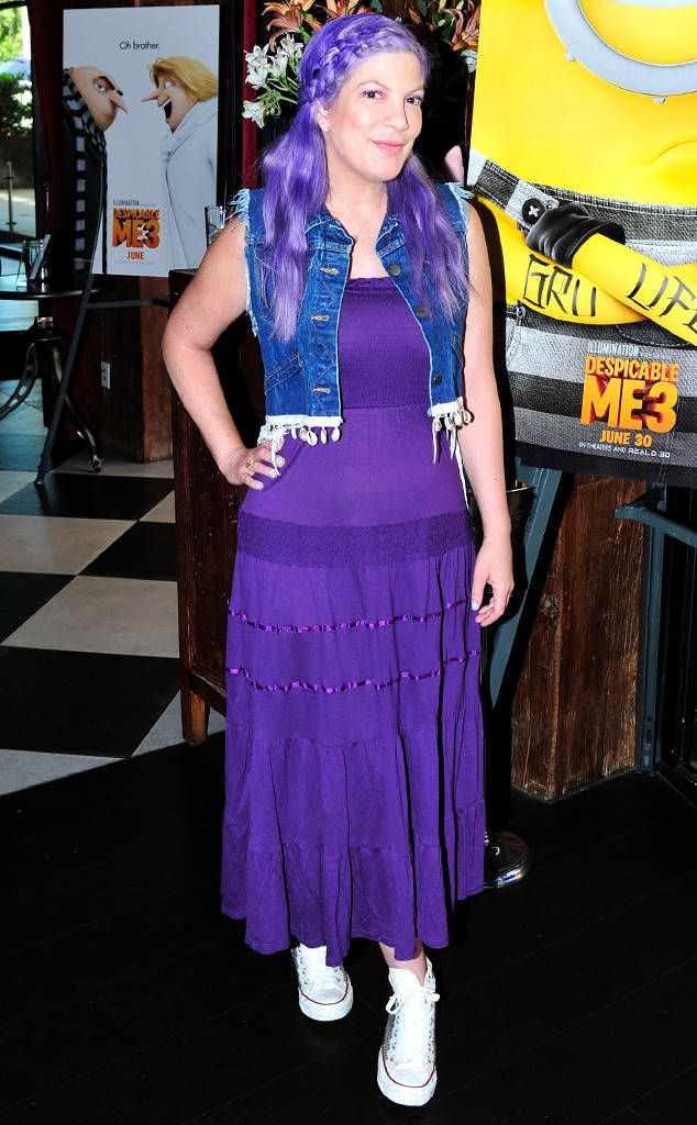 Tori Spelling from The Big Picture: Today's Hot Photos  Purple party! The Hollywood mom and actress is seen sporting purple hair at a local movie theater in Los Angeles.