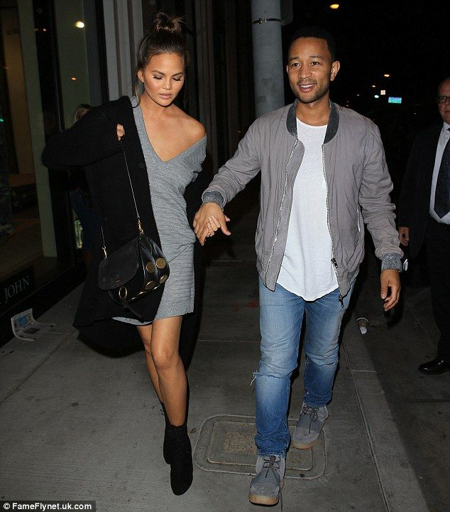 Different moods: Chrissy Teigen looked a bit downcast on a date with husband John Legend at West Hollywood hotspot Catch LA on Thursday evening