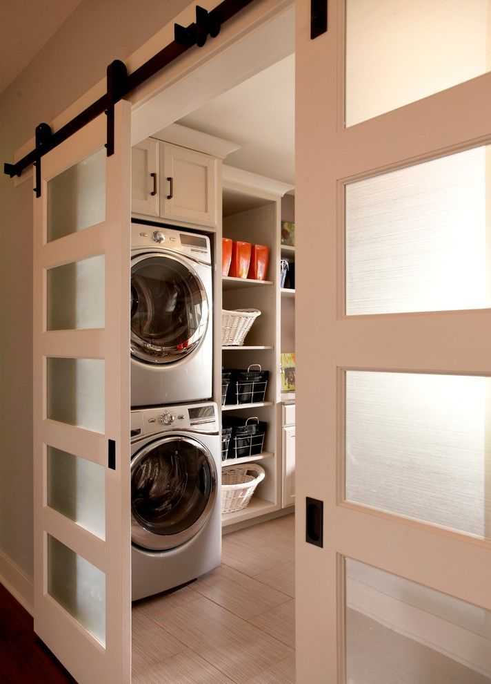 Sliding track doors to laundry room, white and glass doors, wood grain tile | VanBrouck & Associates, Inc.