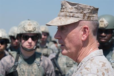 """Marine Corps Gen. Joe Dunford, chairman of the Joint Chiefs of Staff, pictured here in August 2016 speaking to airmen at Incirlik Air Base, Turkey, delivered the keynote speech at the Reagan National Defense Forum in Simi Valley, Calif., Dec. 3, 2016. Speaking on future investments and capabilities, he emphasized the commitment to """"the young men and women in uniform that we will never send them into a fair fight."""" DoD photo by Navy Petty Officer 2nd Class Dominique A. Pineiro"""