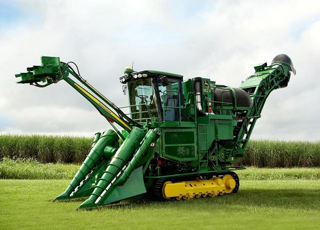 3520 SUGARCANE HARVESTER  -    The parallel linkage crop dividers adapt to ground unevenness for cleaner cane and reduced losses. A wide throat and 45-degree approach angle gently handle even the heaviest cane and consistently maintain the proper orientation to the ground. The benefit is that it reduces dirt content while minimizing whole stalk losses under the crop-divider toe as the row height varies.