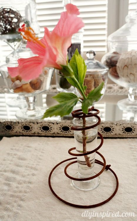 Insert a tall glass shot glass to make a pretty vase- Repurposed Bed Springs and Chair Springs