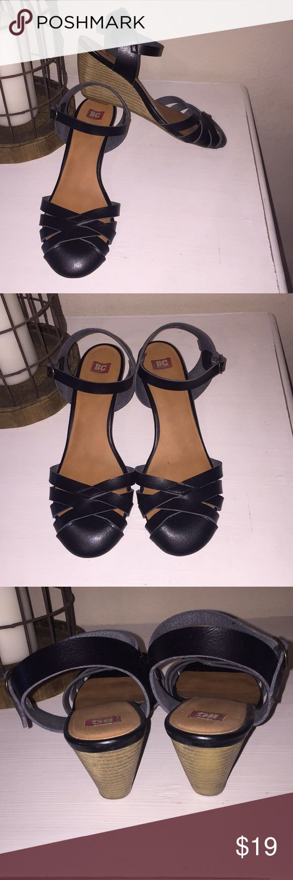 BC Footwear Black Strappy Wedges, Size 8.5 BC Footwear Black Strappy Wedges, Size 8.5. These wedges are so cute and can be dressed up or dressed down! The modest heel and wedge allow for comfort and stability. There is a closed toe for when you need to look cute, but your polish may not be on point 😝Good used condition, they have been well loved, but still have life left. I do not have the original box. *Note: Flash used due to dreary day. BC Footwear Shoes Wedges