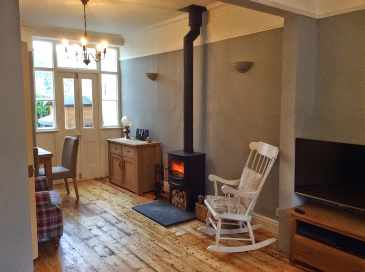 Charnwood C5 on log store set on a nice thick riven slate hearth. This installation was in a house which had downstairs chimney breast removed. We fitted a chimney liner into upper masonry chimney and used twin wall flue to connect to it. There's always a way!