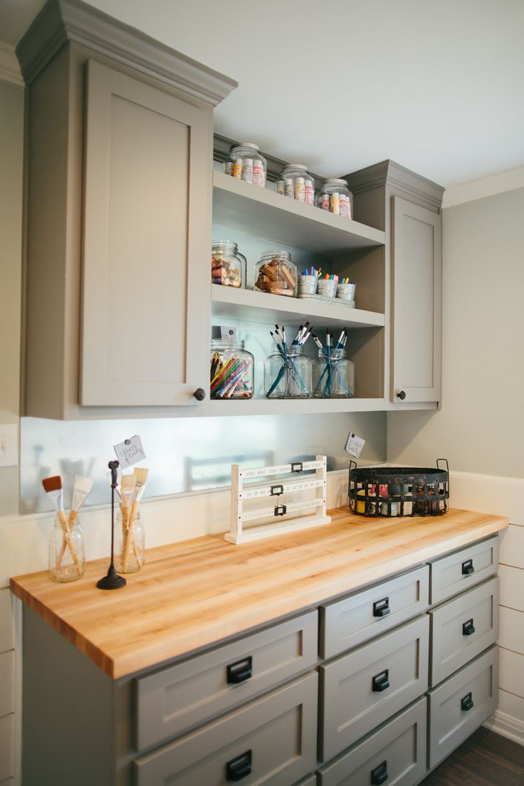 Fixer upper white kitchen cabinet color - We Started By Designing Custom Built In Cabinets And Open Shelving For Her Supplies Storage The Butcher Block Countertops Brought Warmth To The Dark Gray
