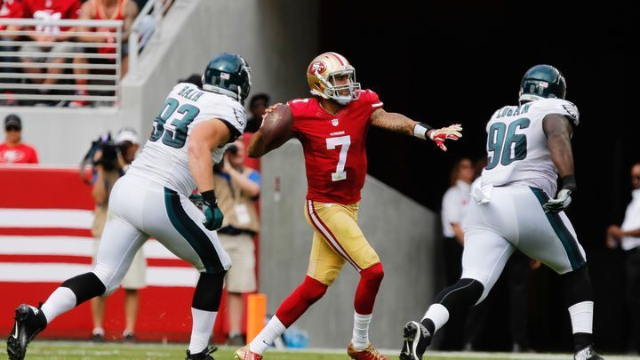 San Francisco 49ers quarterback Colin Kaepernick looks to pass the ball with pressure from Philadelphia Eagles defensive end Brandon Bair and nose tackle Bennie Logan during a 2014 game.