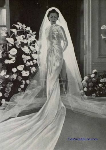 June is for brides. Satin wedding gown by Callot Soeurs, 1938.