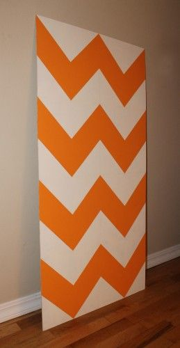 DIY chevron stripe wall art -- with tutorial -- in Tangerine orange!