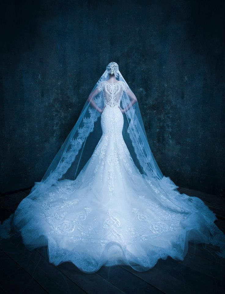 Michael  Cinco | confetti.co.uk  #weddingdress  - Amazing Wedding Dress and Veil.  #afairytalewedding.com
