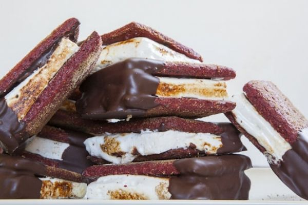 These S'Mores are unlike any other. A red velvet graham cracker blankets a toasted cream cheese marshmallow and is then dipped in a bit of chocolate... need we say more.