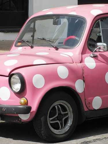 so stinkin' cute! You could never be unhappy driving a pink white polka-dot car!