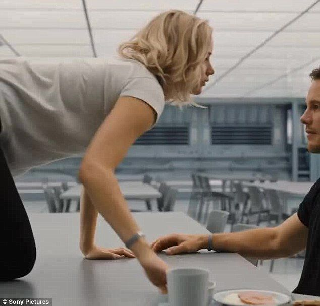 He looks good enough to eat: Jennifer Lawrence crawls over a canteen table to get to Chris Pratt in the Passengers trailer teaser