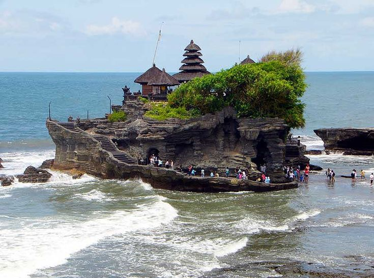 Tanah Lot Temple, is a rock formation, one of the most popular places of interest in Bali, and is located on the coast of West Bali, at the village of Beraban in the Tabanan Regency.