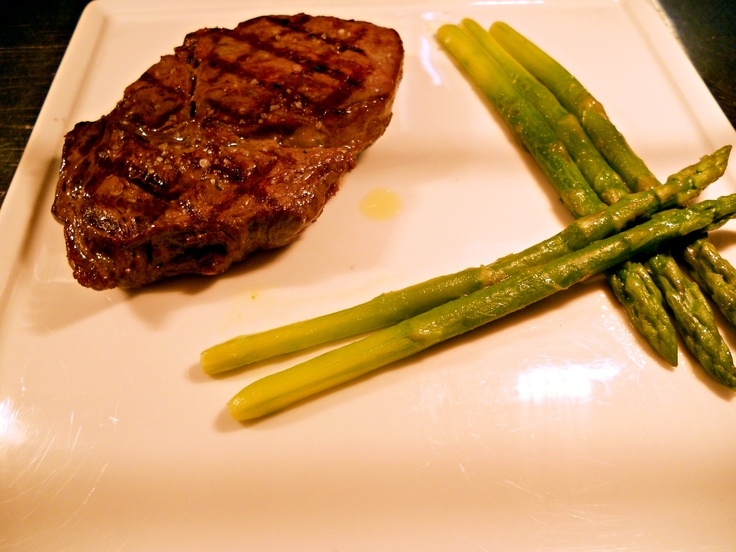 Grilled Argetinian rib-eye steak with asparagus sauteed in butter