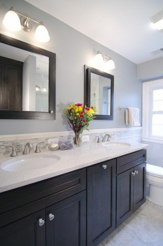 A hall bath that's warm, inviting and neutral. Love the double mirrors instead of one big one