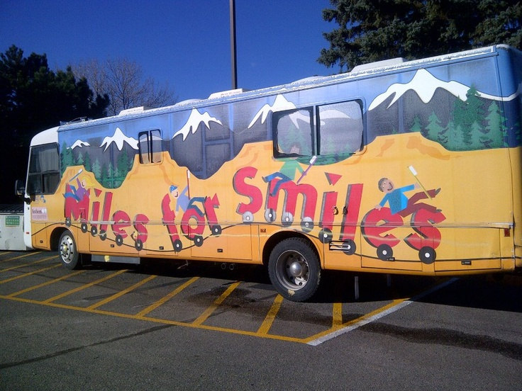 The Miles for Smiles mobile dental clinic parked at Rose Hill Elementary School in Commerce City, CO for free dental exams and treatment thanks to the funding from New Image Dental Center's WellnessAd.