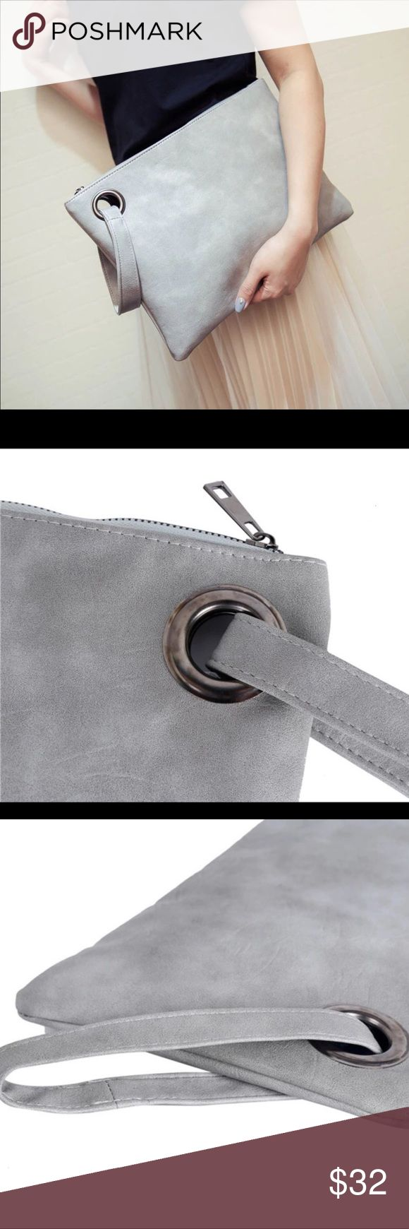 """SIDE STRAP FAUX LEATHER CLUTCH Beautiful and chic envelope clutch bag in a gorgeous faux grey!  Pretty lining on inside with zipper pouch and two compartments.  Approximate Measurements  8"""" x 12.5"""" Bags Clutches & Wristlets"""
