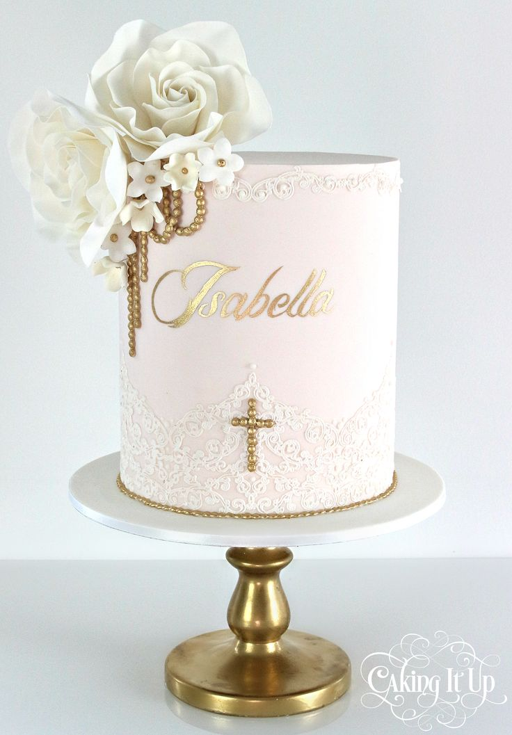 A classy and elegant one tier christening cake featuring a soft pink canvas…