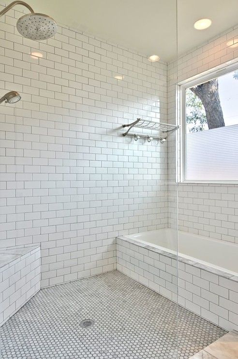 Wet Room Bathroom With Carrera Marble Hex Tiled Floors Alongside Floor To Ceiling Subway Tile