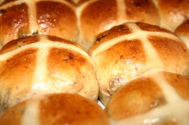 """Recipe for The Best Hot Cross Buns - They say that if you share a hot cross bun with someone your friendship throughout the coming year is ensured, especially if you say """"half for you and half for me, between us two shall goodwill be'. Traditionally eaten on Good Friday, the Hot Cross Bun, fragrant in cinnamon and the soft, warm doughy goodness gets baked and topped with a frosting in the shape of a cross."""