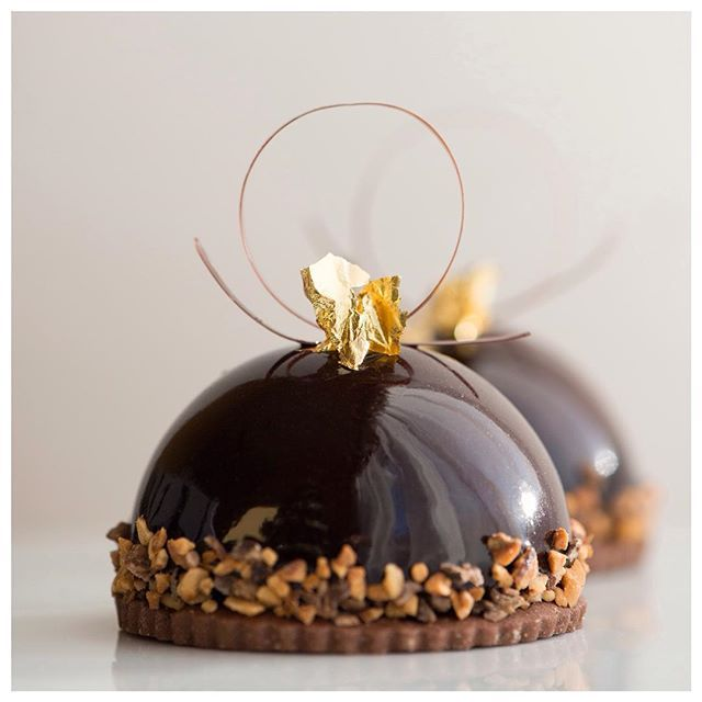 Chocolate mousse petit gâteau, filled with a silky berry brûlée, creamy praline, and a layer of light chocolate sponge