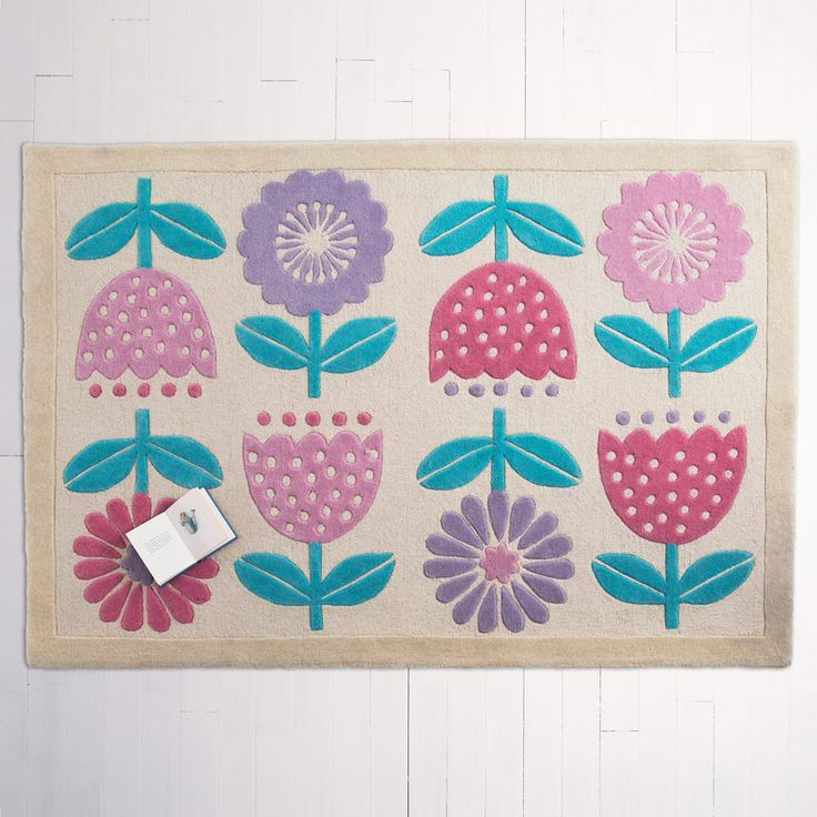 Tip toe, through the tulips... This glorious wool rug is comfortingly thick and will bloom through any gloom.