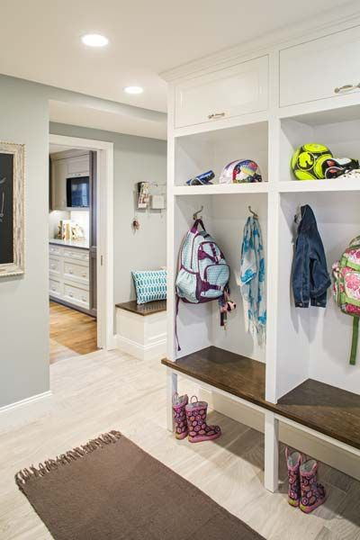 Cubbies in the mudroom encourage the kids to shed their gear before hitting the kitchen on the way in from the front porch. Garage access is around the corner to the right.