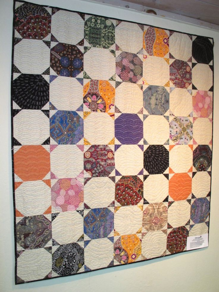 Snowball, by Diana McCLun and Laura Nownes, quilted by Victoria McEnerney, in: Quilts! Quilts!! Quilts!!! 3rd edition by Diana McClun and Laura Nownes.  Photo by The Plaid Portico.
