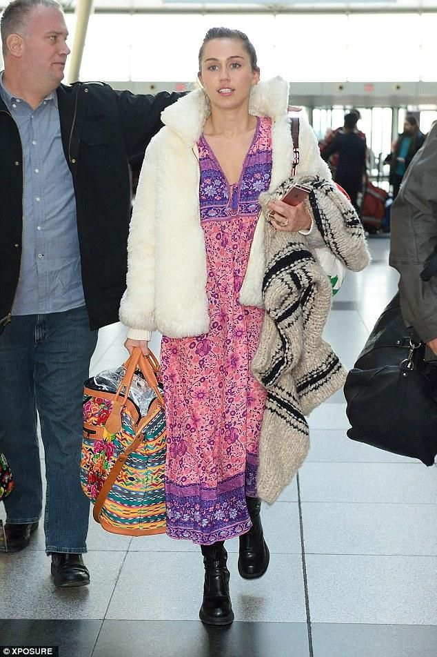 Miley Cyrus wearing Vagabond Tyra Mid High Boots, Spell Folk Town Boho Dress and Spell Gypsy Weekender