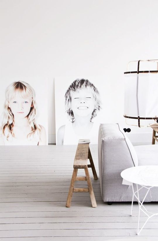 Oversized Photo Portraits Large-scale, expressive portraits add personality to an otherwise sparsely decorated space. To get the look, use a photo editing program to make your images black and white and remove the background. Find helpful hints for preparing your photos on Chris Loves Julia. When your photos are ready, order engineering prints of the images from Kinkos or another local print shop. To imitate the frameless photos above from Woonguide, ask the shop to mount the prints to foam…
