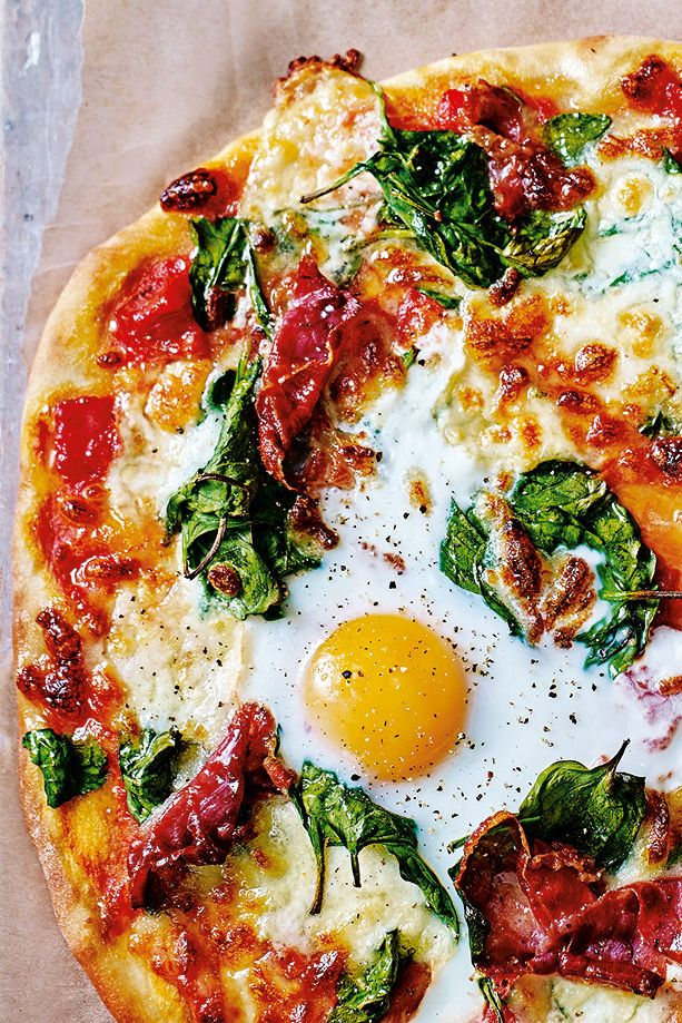 Silky spinach, tangy tomato and salty Parma ham sit neatly on a traditional pizza base, topped with a perfectly cooked egg – this classic Italian Florentine pizza recipe boasts vibrant, fresh flavours for a delicious dinner idea that's perfect for sharing. | Tesco