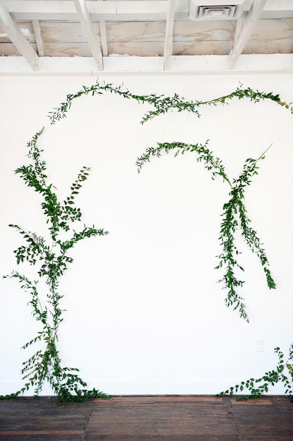 DIY vine wall backdrop - photo by Kristina Curtis Photography http://ruffledblog.com/diy-vine-wall-backdrop #diybackdrop #weddingideas