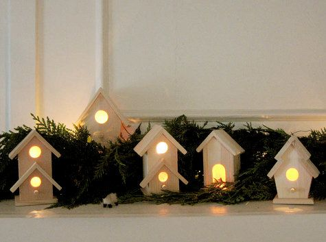 White Christmas Village out of birdhouses.