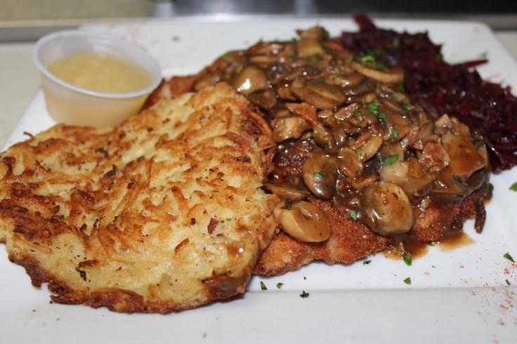 breaded pork cutlet with a hunter style mushroom gravy, potato pancake & traditional German cabbage