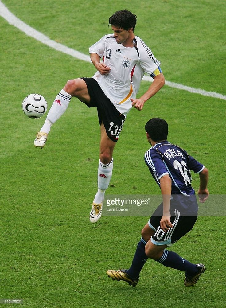Michael Ballack of Germany wins the ball under pressure from Juan Riquelme of Argentina during the FIFA World Cup Germany 2006 Quarter-final match between Germany and Argentina played at the Olympic Stadium on June 30, 2006 in Berlin, Germany.