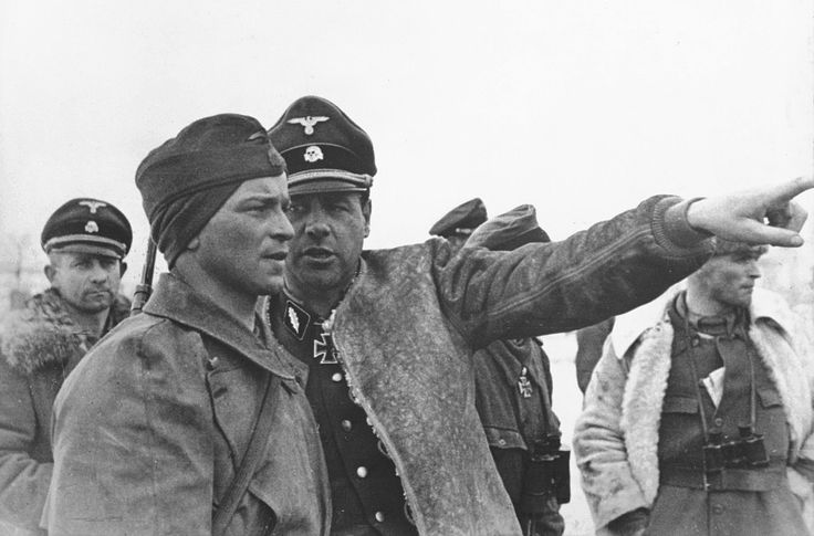 Waffen-SS Standartenfuhrer Fritz Witt (1908-1944) is pointing toward the target to Hauptsturmfuhrer Max Wünsche (1914-1995) in the village of Peresechnaya near Kharkov during bitter fighting with the Russians (February-March 1943). Witt was killed in Normandy. Wünsche was a battalion commander later captured by the Allies. He was released in 1948.