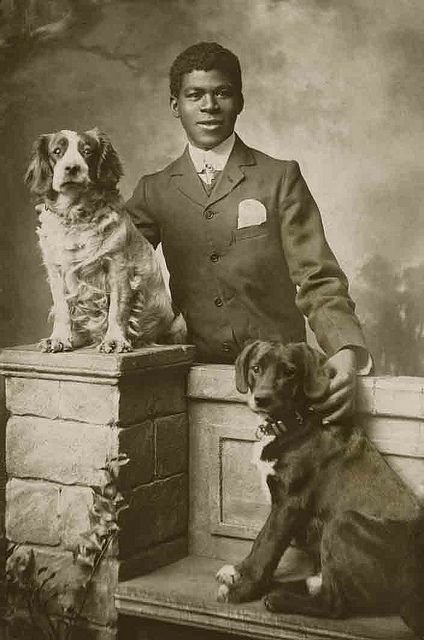 Charming fellow with his dogs, Clacton on Sea 1907