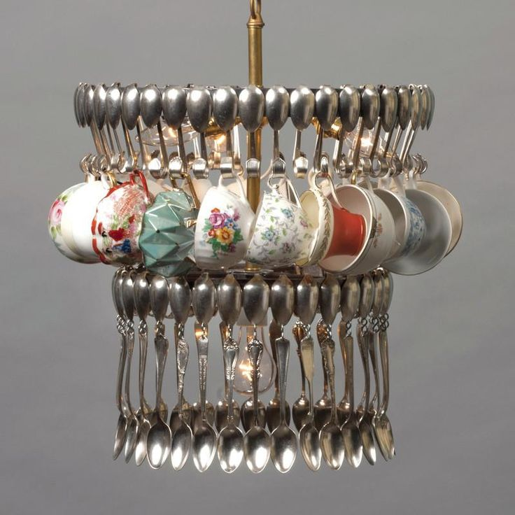 An eclectic combination of spoons and teacups makes this double tier chandelier light fixture the perfect addition to any kitchen or dining room. Tea cups will vary per light but we will use your collection if you have a set to use.  All lights are made to order and will take 4 to 6 weeks for delivery.