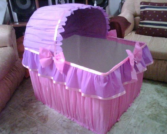 Cardboard and paper crepe to make a crib for all of your baby shower presents!!