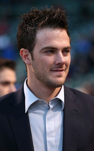 Kris Bryant, the Chicago Cubs 2014 Minor League Player of the Year, waits to be introduced to the fans before the Cubs take on the Cincinnati Reds at Wrigley Field on September 17, 2014 in Chicago, Illinois. The Cubs defeated the Reds 3-1.