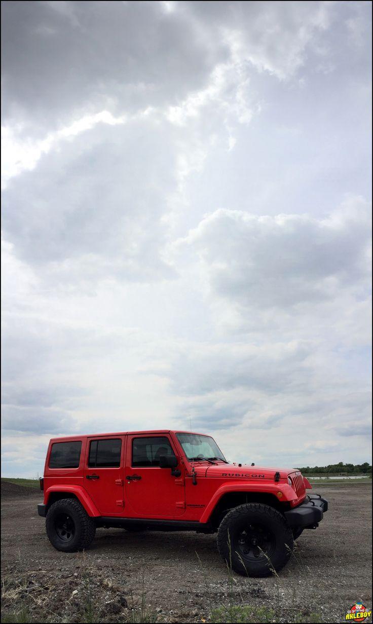 "Red 2015 Jeep Wrangler Rubicon sporting a 2.5"" Teraflex lift, 35"" BFG KO/2 tires…"