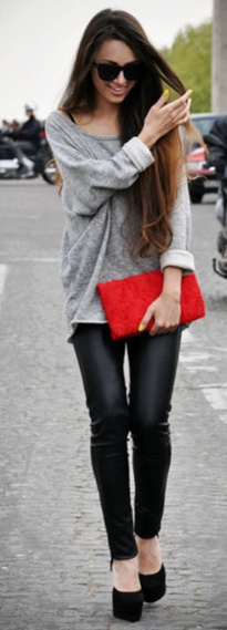 oversize sweatshirt black leather legging with red clutch.  very casual chic.
