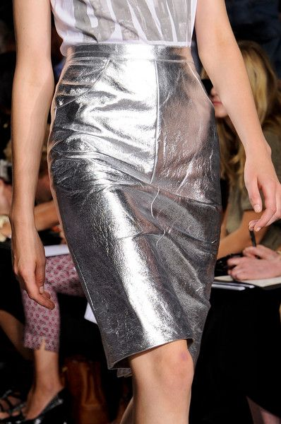 DKNY metallic silver skirt. My daughter says we could make it with duct tape. Crafty girl. But I'm not allowed to use all her duct tape.